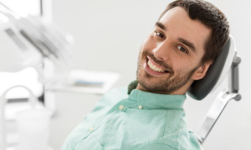 Closeup of man smiling in dentist's treatment chair