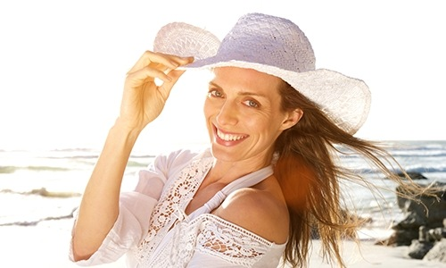 Woman wearing sun hat on the beach
