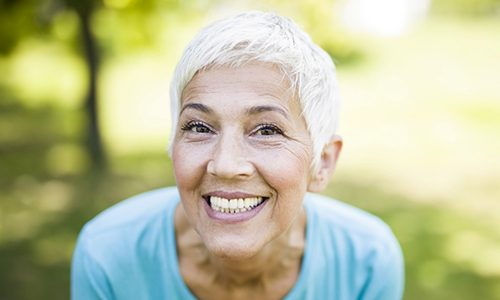 Mature woman showing off her full, beautiful smile