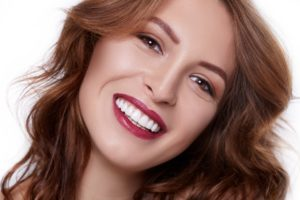 Woman with an attractive smile after cosmetic dentistry in Marathon.